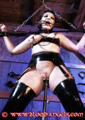 Restrained helpless slavegirl punished.