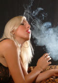 Naughty blond babe with big tits smoking cigarette