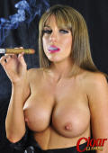 Big bobbed babe Talia smokes a very long cigar and shows off her large breasts.