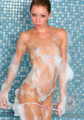 Flatchested girl in soapy bubbles