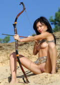 exotic brasilian sport girl with bow and arrow