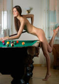 Nude slim beauty on the pooltable