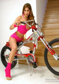 Pink beauty riding her new bike and a lot of dicks