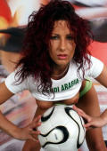 Frizzy haired football babe from Saudi Arabia strips and shows her divine boobs.