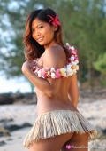 Tina shows off those soft breasts on the beach in her grass skirt.