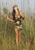 Slim beauty in army dress gets nude