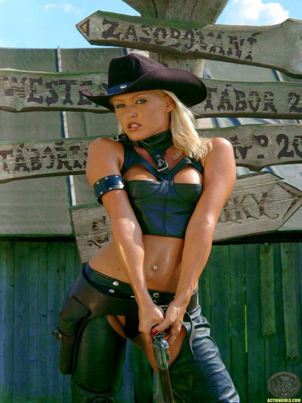 Cowgirl having fun with a gun