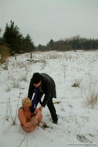 Slavegirl and master outdoor in the snow