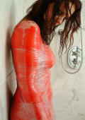 Wet brunette is painted in red ink and wrapped in tight cellophane.