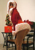 Amber Lily strips out of her saucy miss SANTA outfit.
